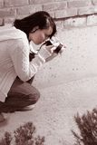 Girl with SLR photo camera Stock Photo