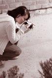 Girl with SLR photo camera. Girl shooting SLR photo camera Stock Photo