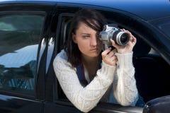 Girl with SLR photo camera. Girl shooting SLR photo camera Royalty Free Stock Photos
