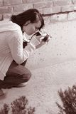Girl with SLR photo camera. Girl shooting SLR photo camera Stock Images