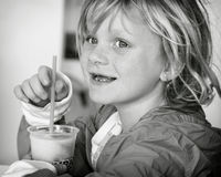 Girl with slushy. A young girl drinking ice cold slushy Stock Images