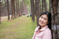 Girl with a smail. In pine plantation Royalty Free Stock Image