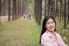 Girl with a smail. In pine plantation Royalty Free Stock Photos