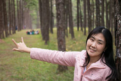 Girl with a smail. In pine plantation Stock Photography