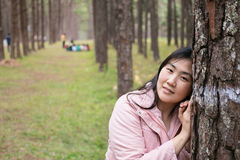 Girl with a smail. In pine plantation Royalty Free Stock Photo