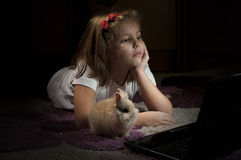 Girl with a small bunny Stock Photography
