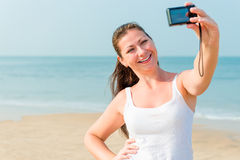 Girl with a small camera Royalty Free Stock Photography