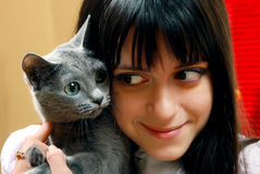 Girl with a small cat Stock Photography