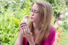 Girl with a small chicken Royalty Free Stock Photography
