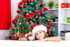 Girl with small Christmas tree Stock Images