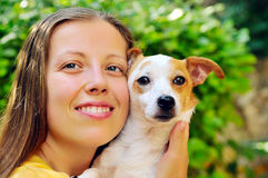 Girl with a small dog Royalty Free Stock Photography