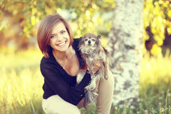 Girl with a small dog. Young girl with a small dog Royalty Free Stock Photo
