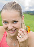 Girl with small flower Royalty Free Stock Image