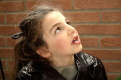 Girl. Small happy little girl look to the sun royalty free stock photography