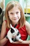 Girl with small rabbit Stock Images