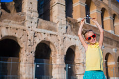 Girl with small toy model airplane on Colosseo background in Rome, Italy Royalty Free Stock Photography