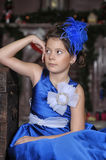 Girl in a smart blue dress Stock Images