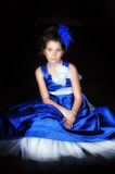 Girl in a smart blue dress Royalty Free Stock Image