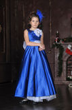 Girl in a smart blue dress Royalty Free Stock Images