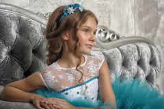 Girl in a smart blue dress with white Royalty Free Stock Images