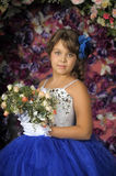 Girl in a smart blue and white ball gown Stock Images