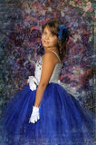 Girl in a smart blue and white ball gown Royalty Free Stock Images