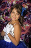 Girl in a smart blue and white ball gown Stock Image
