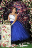 Girl in a smart blue and white ball gown Stock Photography