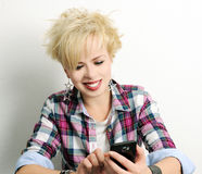 Girl with smart phone. Portrait of beautiful blond girl with smart phone stock photo