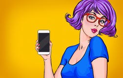 Girl with smart-phone in the hand in comic style. Girl with phone. Girl showing the mobile phone.Girl in glasses. Stock Photo