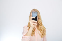 Girl with a smart phone. isolated on white Stock Images