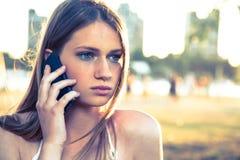 Girl with smart phone near beach Stock Image