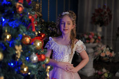 Girl in a smart pink dress in the Christmas Stock Photos