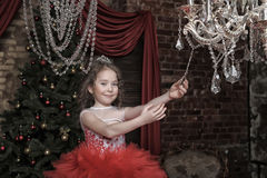 Girl in a smart red dress Royalty Free Stock Image