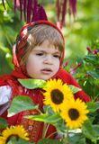 Girl in a smart Sarafan is among sunflowers Royalty Free Stock Images