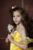Girl in a smart yellow dress Royalty Free Stock Image