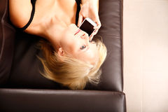 Girl with a Smartphone Royalty Free Stock Photos