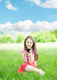 Girl and smartphone Stock Images