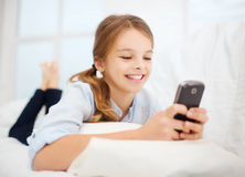 Girl with smartphone at home Royalty Free Stock Photography