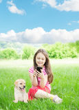 Girl and smartphone and labrador Stock Images