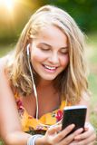 Girl with smartphone outdoors royalty free stock photos