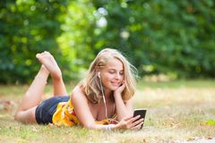 Girl with smartphone outdoors royalty free stock image
