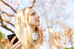 Girl with smartphone in park Royalty Free Stock Photography