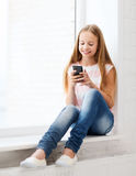 Girl with smartphone at school Royalty Free Stock Photo