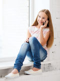 Girl with smartphone at school Royalty Free Stock Photography