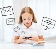 Girl with smartphone at school Stock Photo