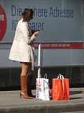 Girl with smartphone and shopping bags Royalty Free Stock Photography