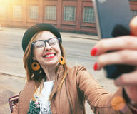 Girl with smartphone taking photo Royalty Free Stock Images