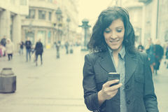 Girl with smartphone walking on city Royalty Free Stock Photos