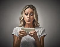Girl with smartphone. Stock Images